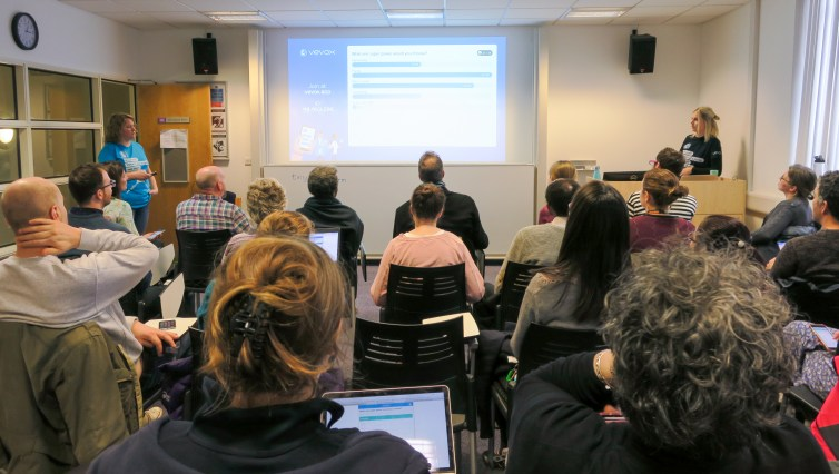 People watching a Vevox presentation in a classroom.