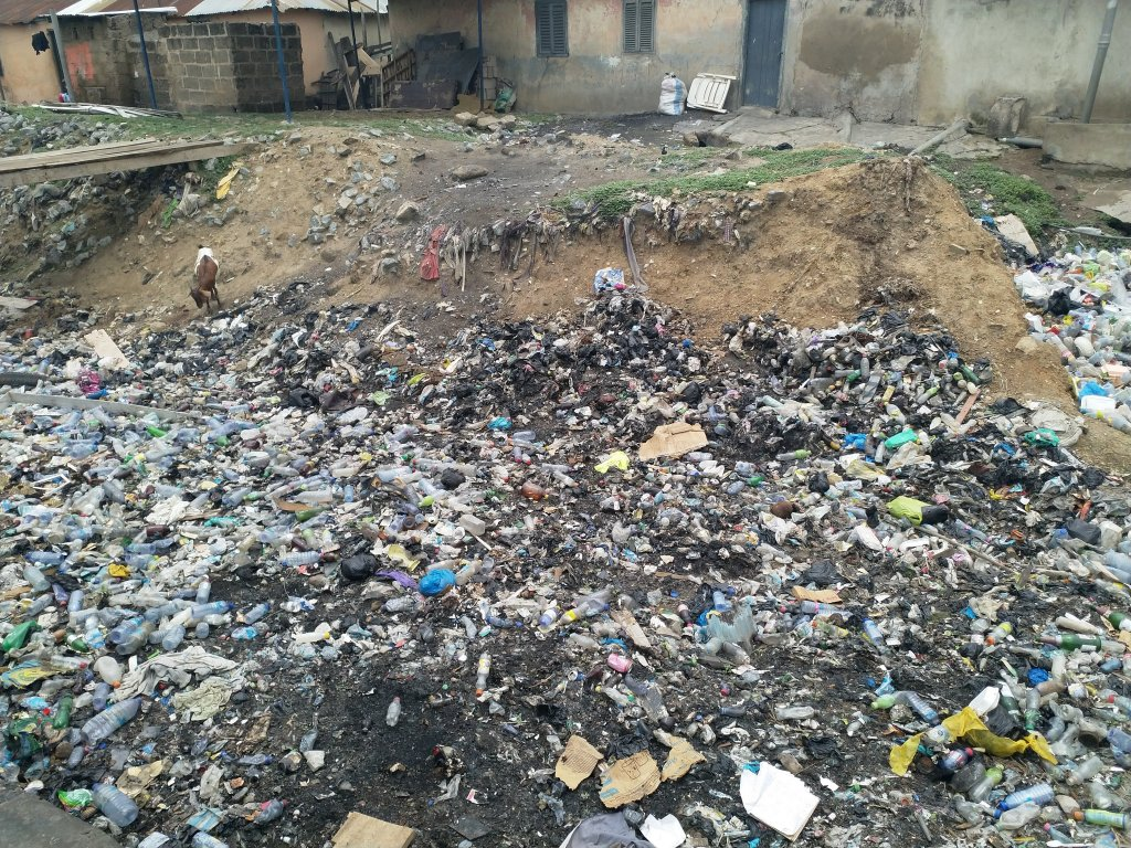 Drainage channel blocked by uncollected waste in Greater Accra (photo credit: Dr. Heini Vaisanen, University of Southampton