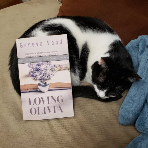 photo of cat and papberback copy of Loving Olivia