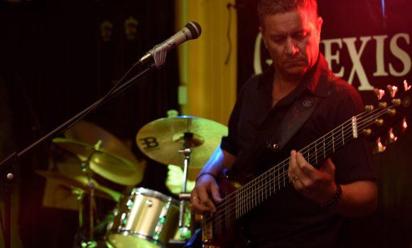 Aaron, bass guitar, Genexis - Yandina Hotel