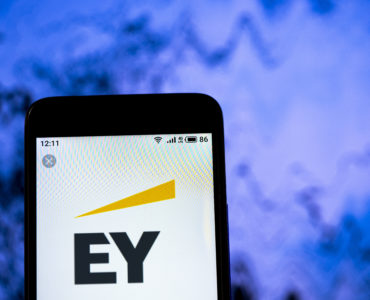 KYIV /KIEV, UKRAINE - July, 4, 2019: In this photo illustration the Ernst & Young logo is seen displayed on a smartphone