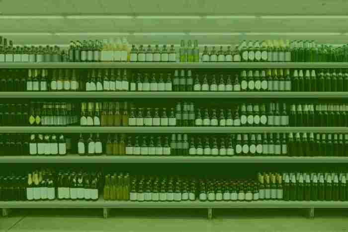 a shelf with white labeled products