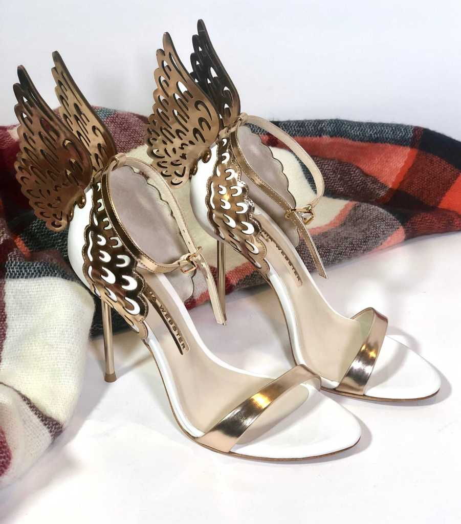 Evangeline Winged Leather Sandals displaying with a plaid scarf