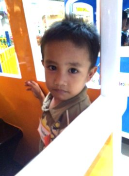 A kid smiles while on the train ride at SM City Cagayan de Oro.