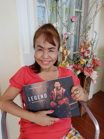 PacMom Dionisia proudly holding the Legend