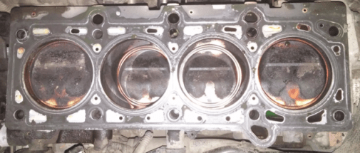 Pistons coated with carbon build up from oil burn