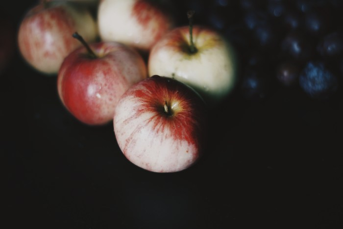 Close-up of apples on black background