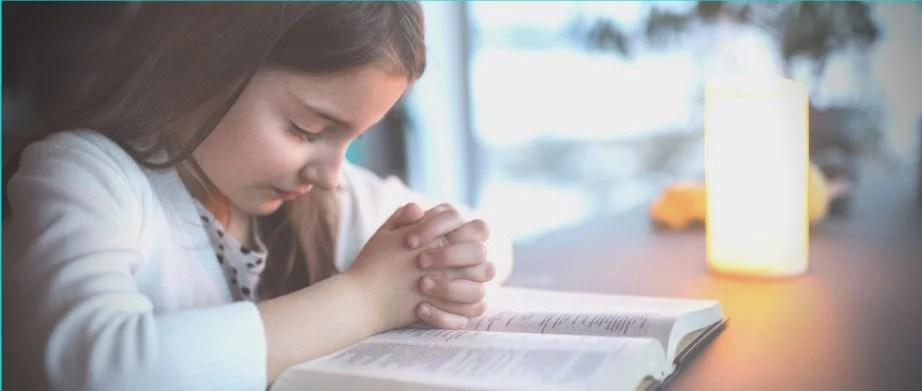 image of girl praying - teaching kids about prayer