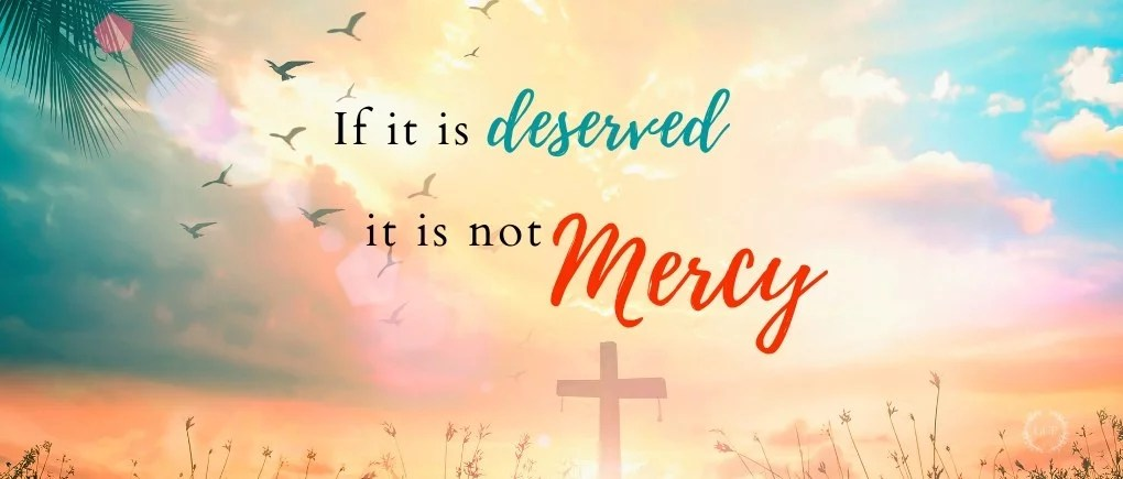"""image of quote """"if it is deserved, it is not mercy"""" with sunset and cross"""