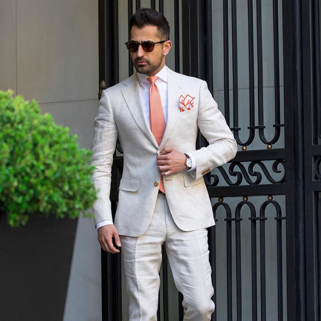 All white pocket suit with a nice handkerchief