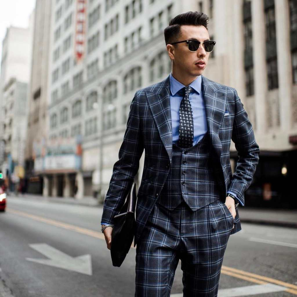 Patterned grey modern power suit with a blue button up