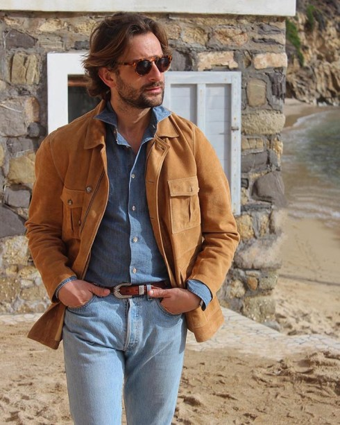 A suede jacket combined with a denim shirt and denim trousers.