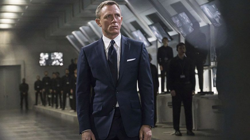 Daniel Craig wearing a suit that way too tight in the movie James Bond.
