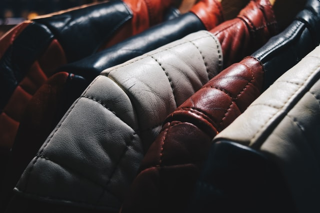 manly leather jackets hanging in a wardrobe