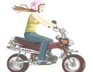 原付バイクに乗る女性