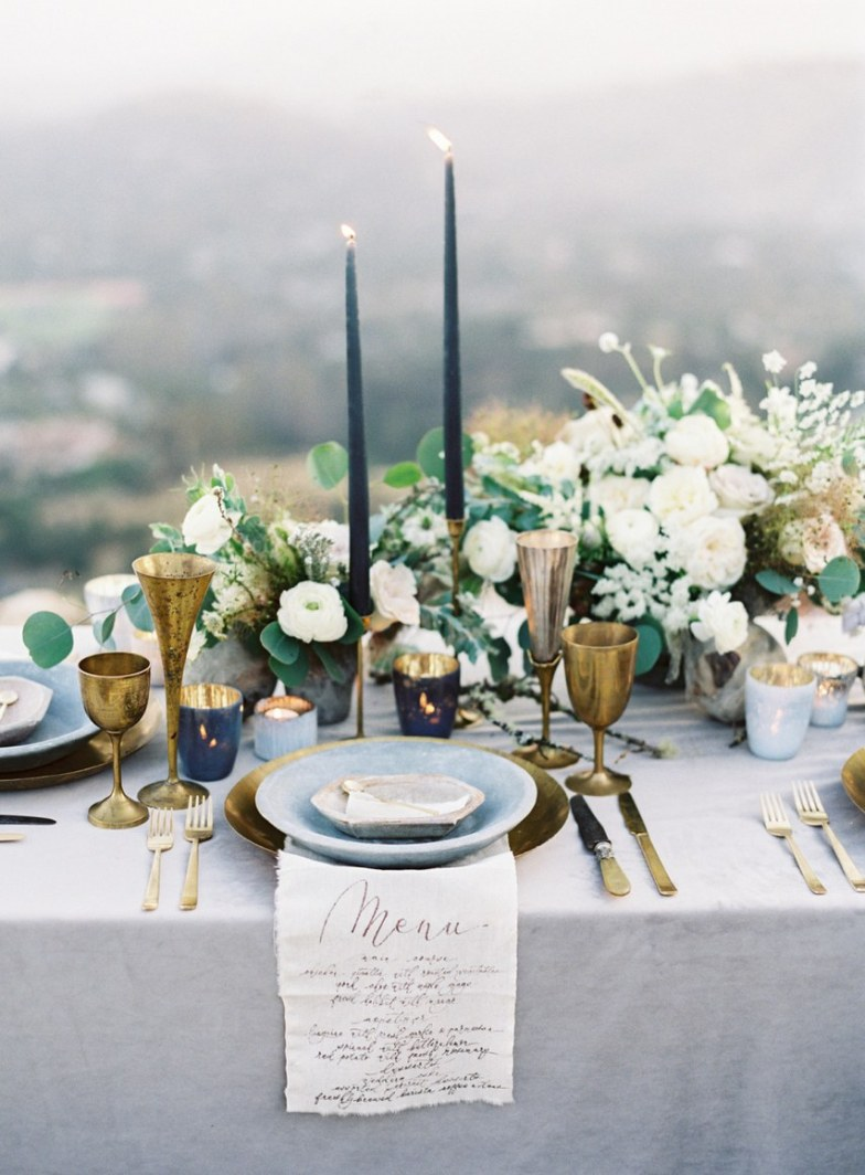 Taper candles for wedding decor blue and gold table setting