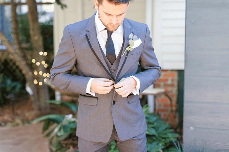 groom in gray tuxedo