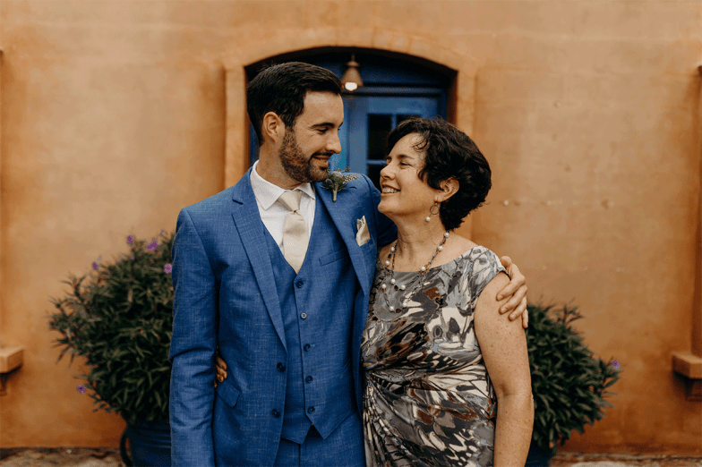 groom in blue suit with mother of the groom