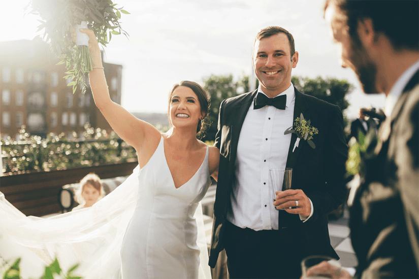 bride and groom in black tuxedo