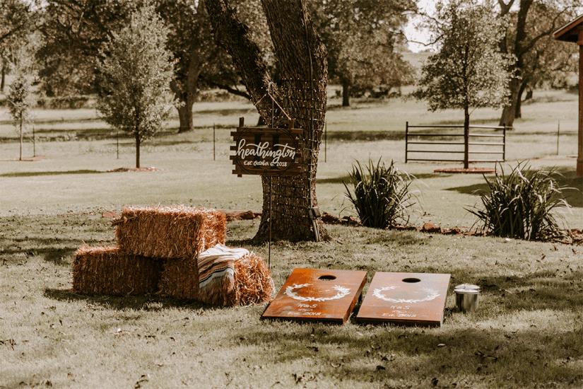 backyard wedding decorations and cornhole baords