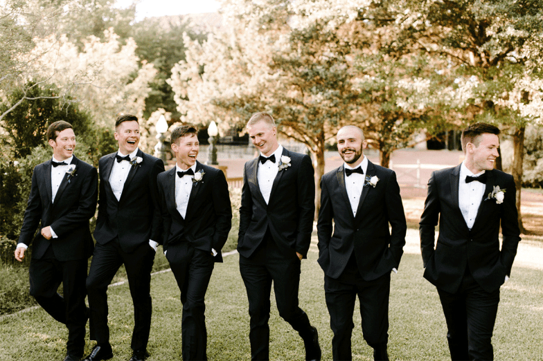groom and groomsmen in black tuxedos