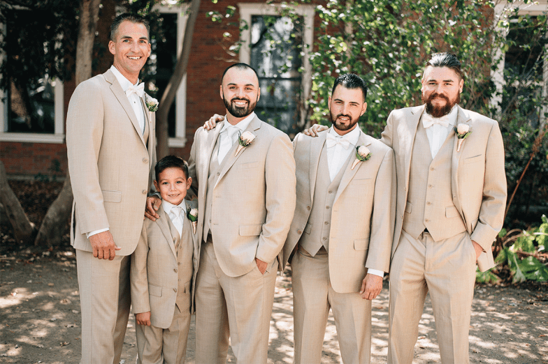 groom and groomsmen in tan suits