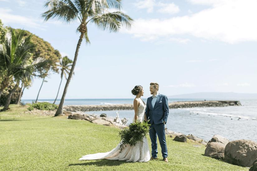 bride and groom in blue suit at hawaiian destination wedding