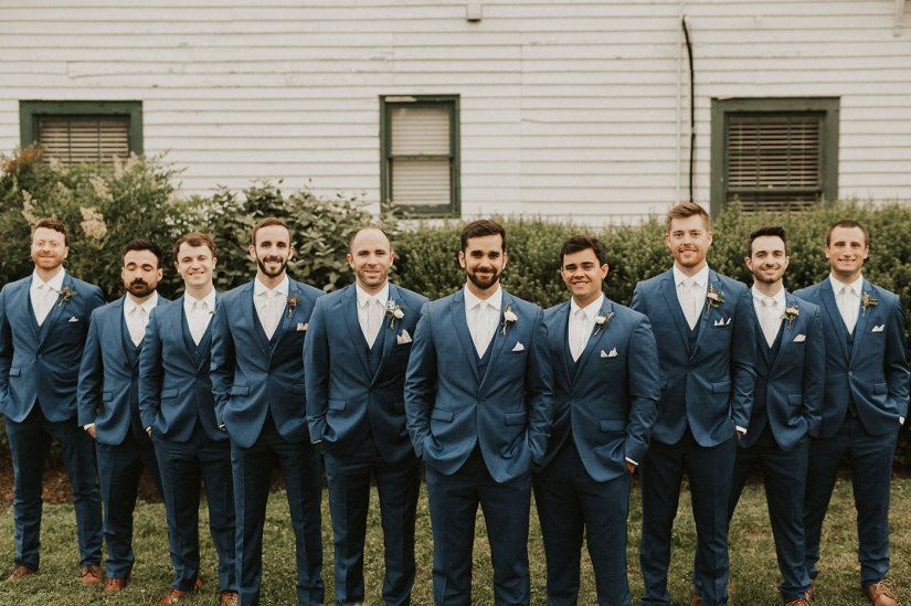 groom and groomsmen in blue suits