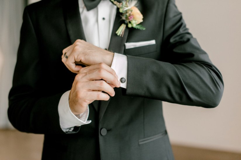 cufflinks and a black tuxedo
