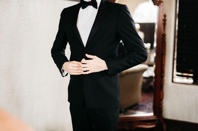 groom in black tuxedo