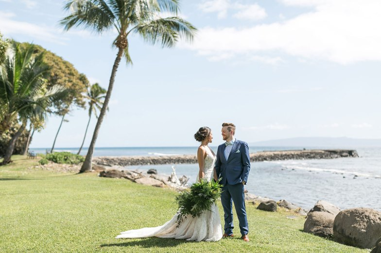 bride and groom in blue suit at hawaii destination wedding