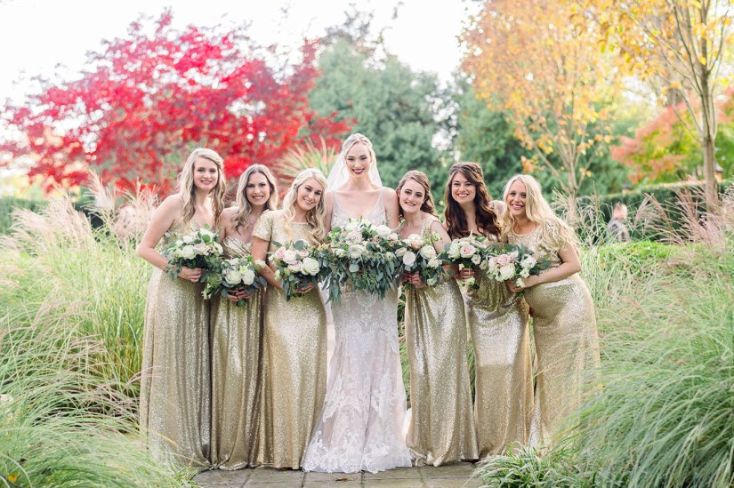 bride with bridesmaids in gold dresses