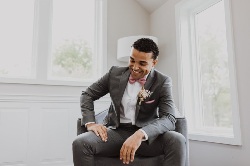 Groom wearing Generation Tux Iron Gray Suit with Chianti Rose Bow Tie