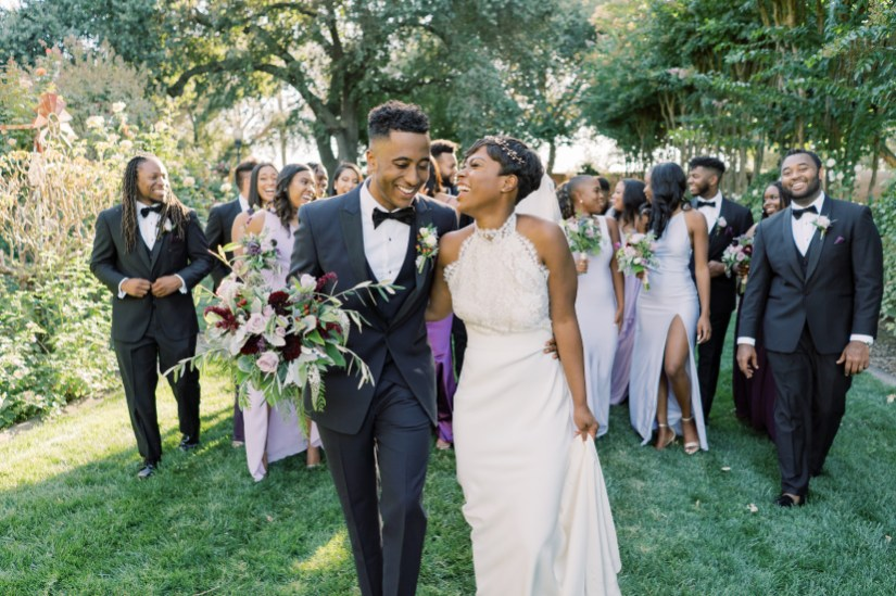 Groom wearing Generation Tux Black Peak Lapel Tux