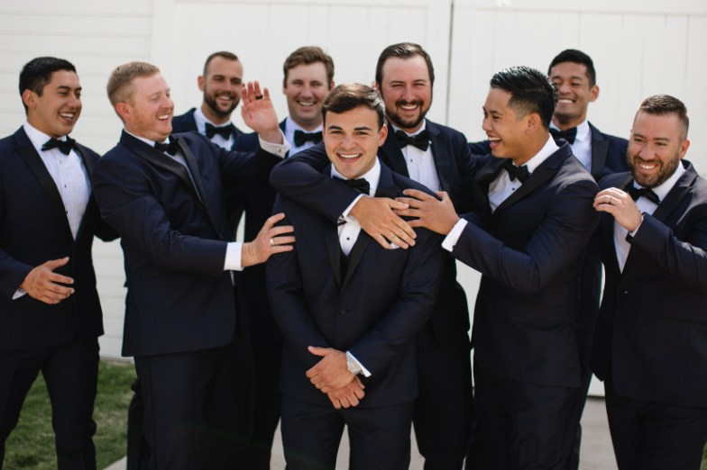 Groomsmen wearing Generation Tux Midnight Blue Tux