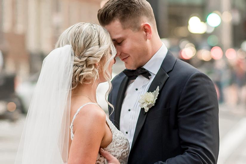 Bride and Groom in black wedding tuxedo