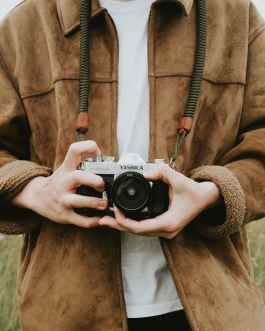 photo of person holding camera