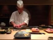 Chef moulding sushi