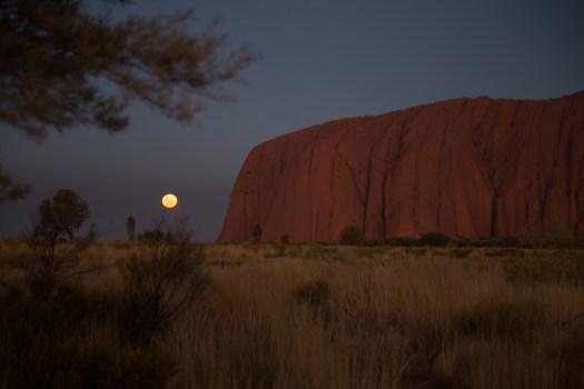 Image of moon rising over Uluru