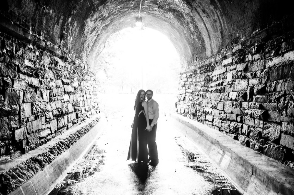 Engaged couple in a tunnel.
