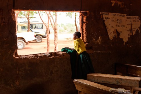 A school girl looks on on World Environment Day.
