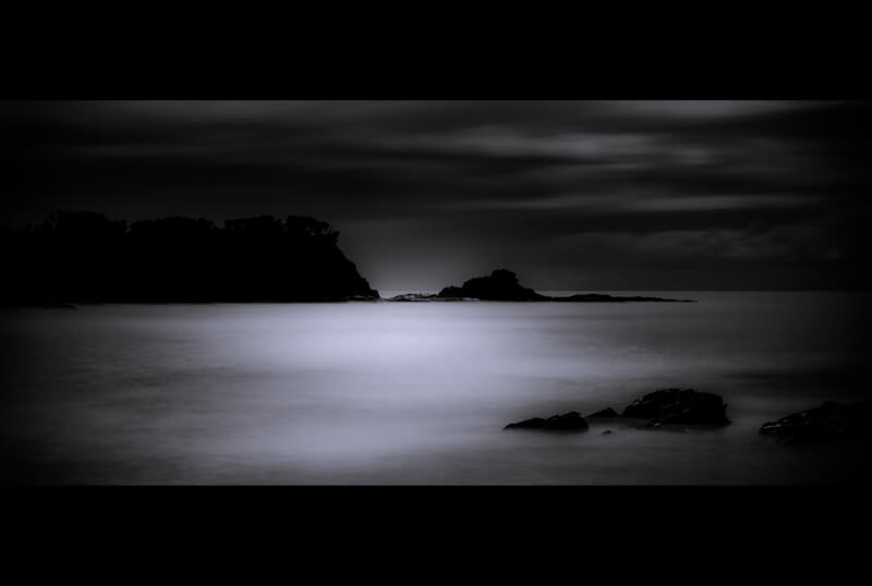 Long exposure of coastal headland by moonlight