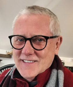 Headshot of Geoffrey Wells
