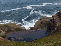 Rock pool and surf