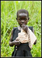 Aloyo Innocent - 6 years old and attends Awere Primary School.