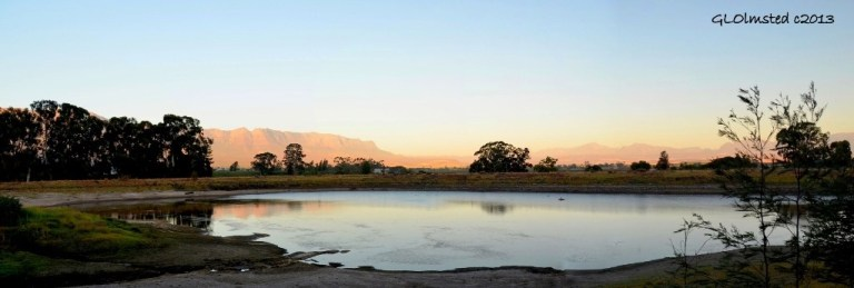 Late light on mountains across dam at Rhodene Farm Cottage Ceres SA