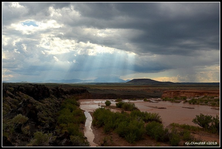 Little Colorado River & sun rays over Mt Humphreys Navajo Reservation Arizona