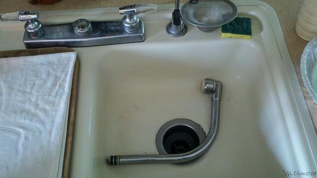 Broken faucet in sink
