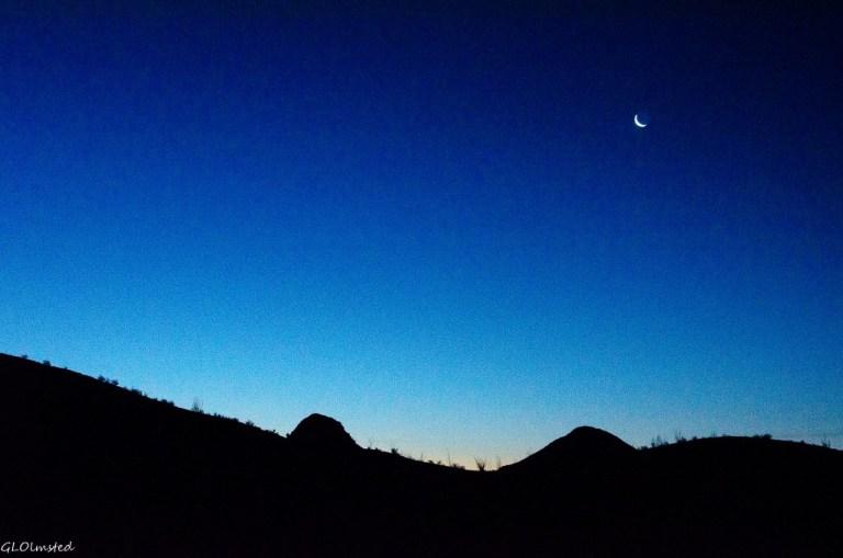 Crescent moon above mts Dome Rock Quartzsite Arizona
