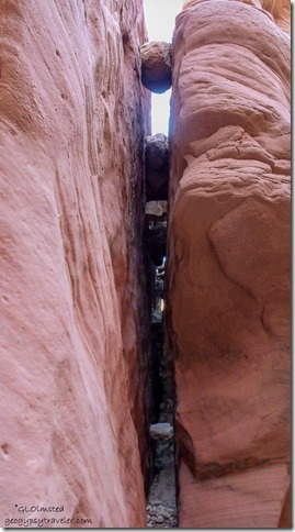 Boulders stuck in crack along slot canyon Wire Pass trail Grand Staircase-Escalante National Monument Utah